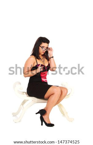 Woman in black skirt and high heels, isolated on white