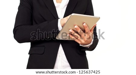 Woman in black suit using a digital tablet. - stock photo