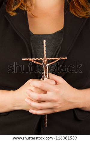 Woman in black with the cross in hands, isolated - stock photo