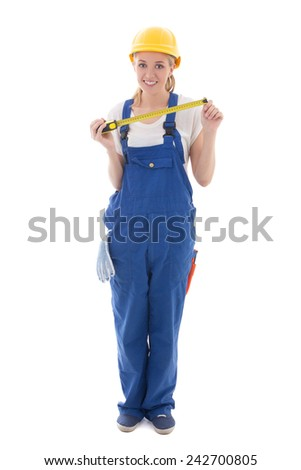 woman in blue builder uniform and helmet holding measure tape isolated on white background - stock photo