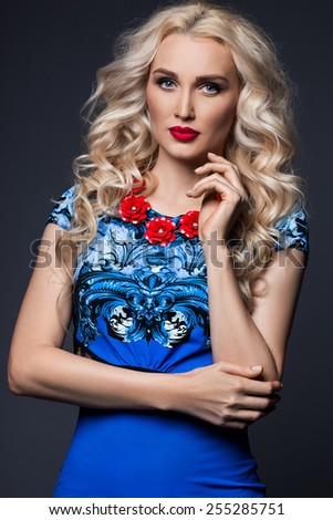 woman in blue dress on black background - stock photo