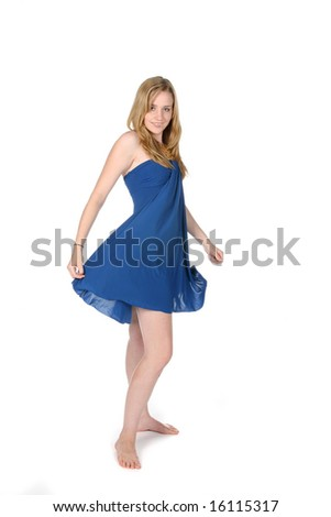 woman in blue dress twirling around - stock photo