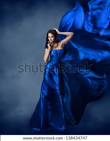 Woman in blue dress with flying silk fabric, Model posing and cloth fluttering on wind