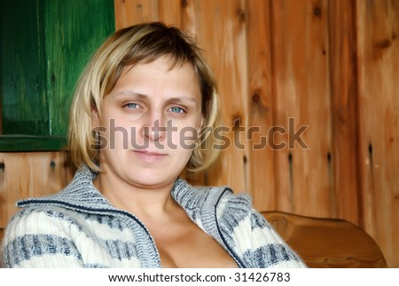 Woman in blue sweater - stock photo