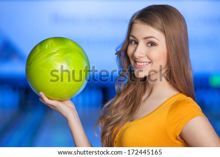 Woman in bowling alley. A woman having fun while bowling.