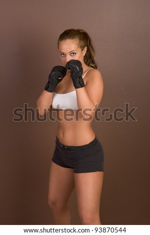 Woman in boxing gloves - stock photo