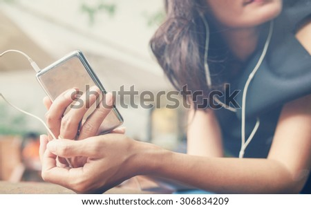 woman in bright outfit enjoying the music at home,vintage - stock photo