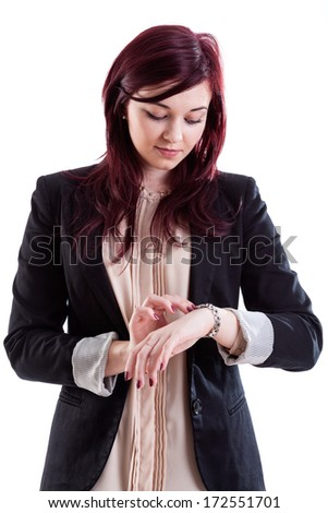 Woman in business outfit looking on her handwatch - stock photo
