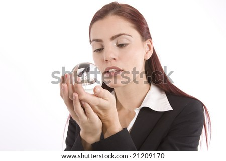Woman in business suit holding a crystal ball in her hands - stock photo