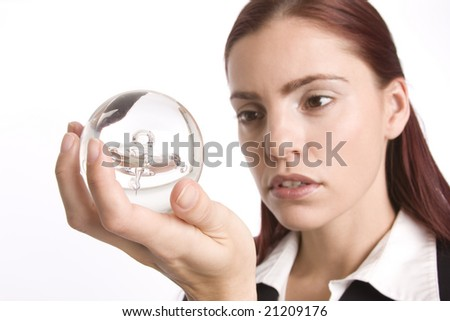 Woman in business suit holding a crystal ball in her hands