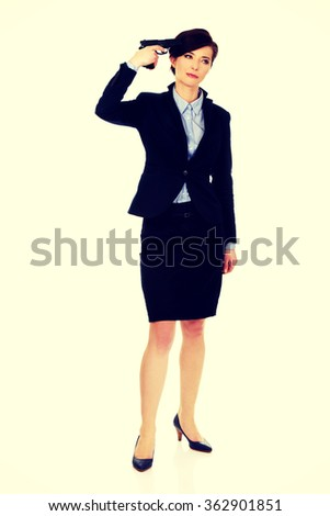 Woman in business suit holding a gun. - stock photo