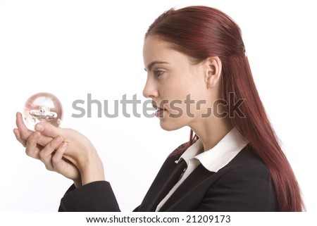 Woman in business suit holding crystal ball in her hands - stock photo