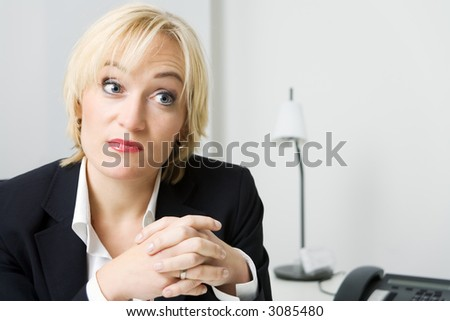 woman in business suit looking rather puzzled