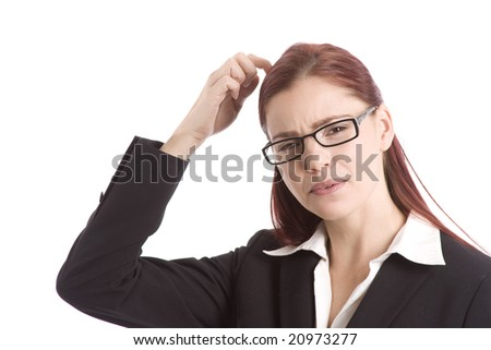 Woman in business suit scratching her head in wonderment - stock photo