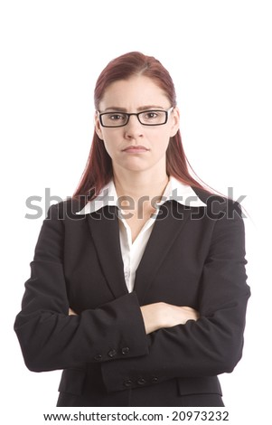 Woman in business suit with arms folded across chest looking stern