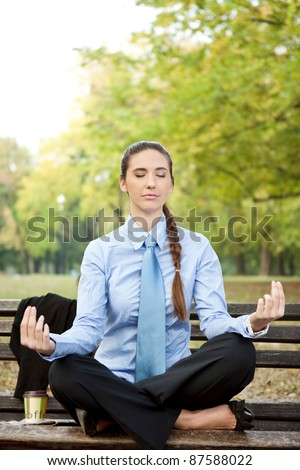 Woman in business wear relaxing in nature - stock photo