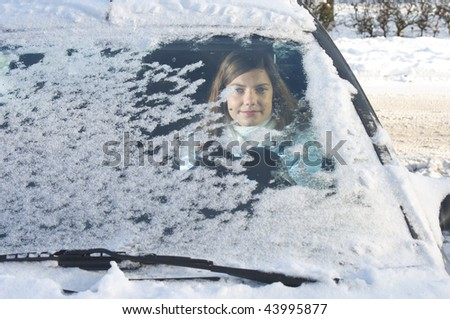 woman in car in winter - stock photo