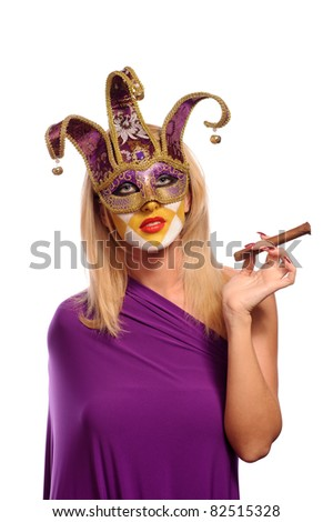 Woman in carnival venetian mask posing with cigar isolated on white - stock photo