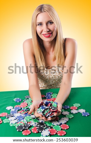 Woman in casino playing cards - stock photo