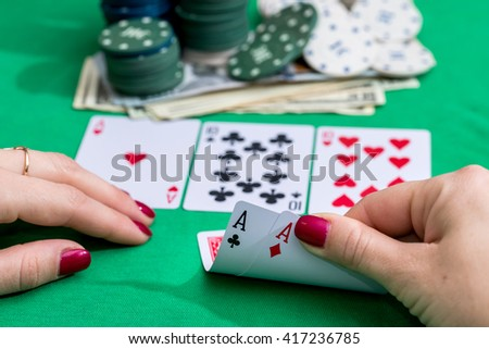 Woman in casino with two aces
