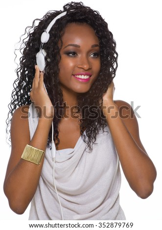 Woman in casual outfit listen to music with headphones - Isolated