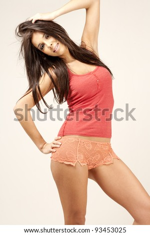 Woman in casual vest top and underwear