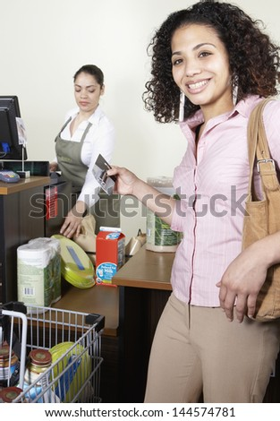 Woman in checkout line at grocery store