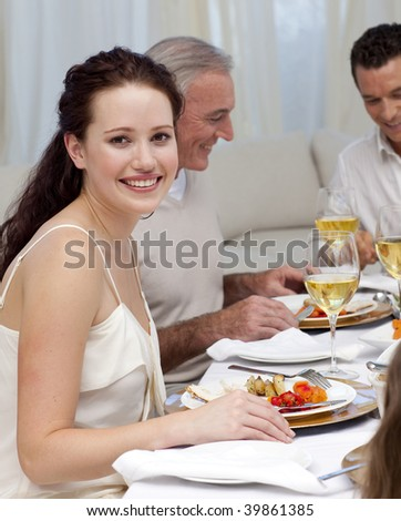Woman in Christmas dinner with her family at home