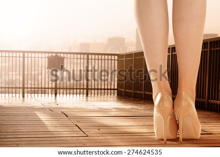 woman in city and sunset time  - stock photo