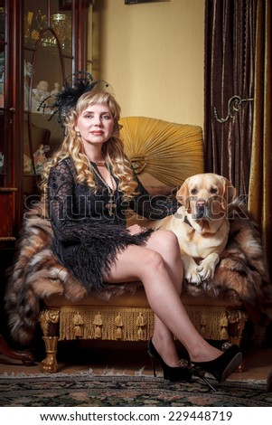woman in classic interior with labrador