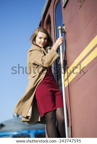 Woman in coat and brown wagon from stain - stock photo