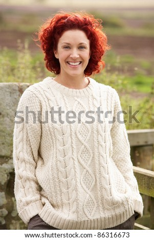 Woman in countryside - stock photo