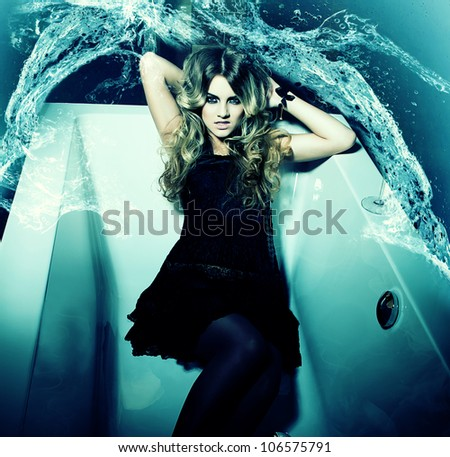 woman in dark bath and water