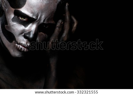 Woman in day of the dead mask skull face art. Halloween face art on black background