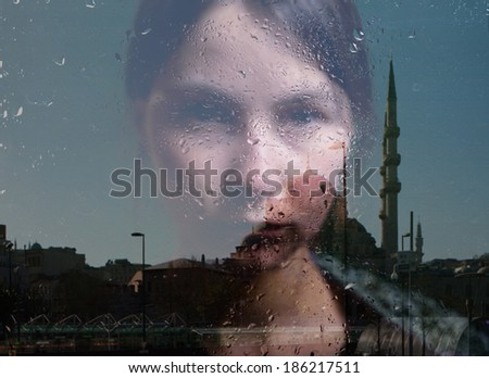 woman in depression, mosque reflection - stock photo