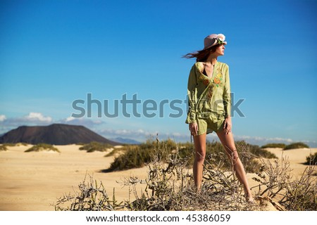 Woman in desert landscape in Canary islands near africa - stock photo