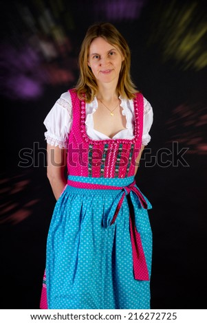 Woman in dirndl at Oktoberfest - stock photo