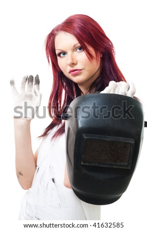 Woman in dirty gloves hold welder - stock photo