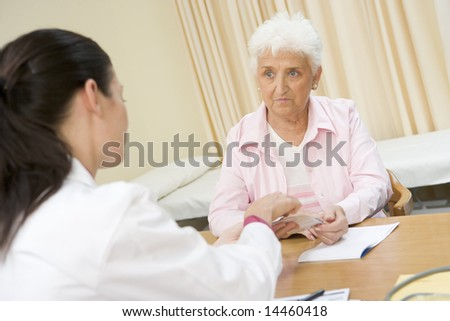 Woman in doctor's office frowning