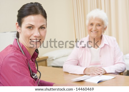 Woman in doctor's office smiling - stock photo