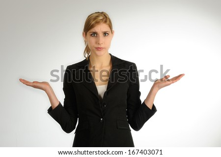 Woman in doubt showing open palms - stock photo