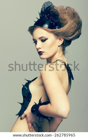 Woman in dress and diadem made of molten vinyl disk - stock photo