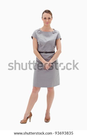 Woman in dress holding her hands against white background - stock photo