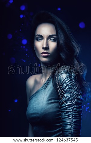 woman in dress in blue light - stock photo
