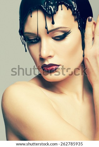 Woman in dress made of molten vinyl disk - stock photo