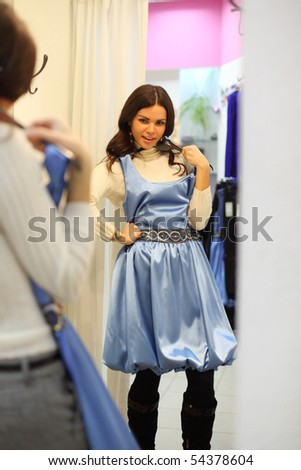woman in dress room