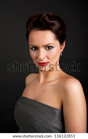 Woman in elegance style on black background