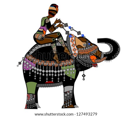 Woman in ethnic style sits on the back of a large elephant - stock photo