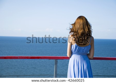 Woman in expectation looking at sea - stock photo