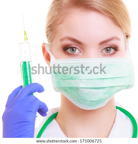 Woman in face mask and white lab coat. Doctor or nurse with syringe isolated. Medical person for health insurance. - stock photo